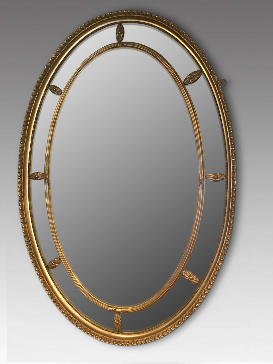 Antique gilt oval wall mirror