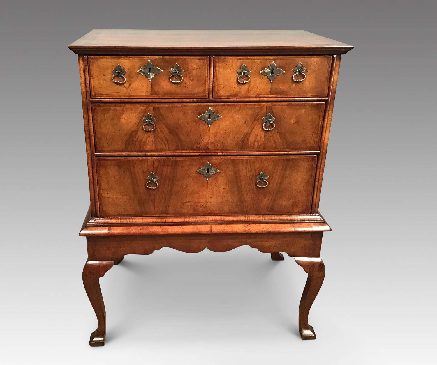 Early 18th century walnut  chest on stand.