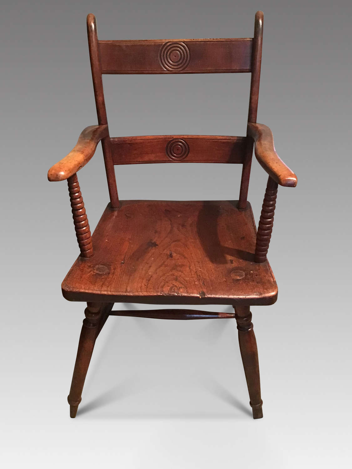 Victorian elm and beech elbow chair.