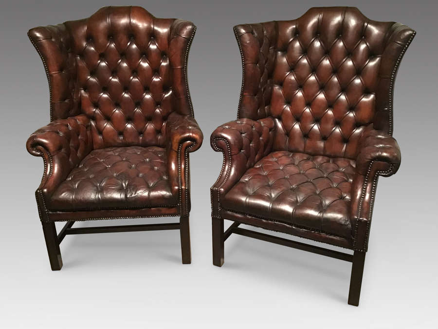 Pair of antique leather wing chairs