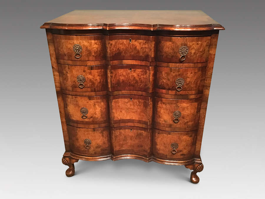 Antique walnut chest of drawers.