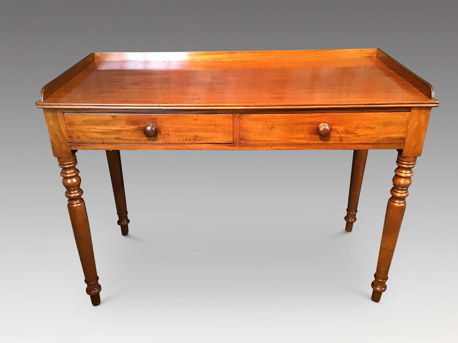 Antique mahogany sidetable.