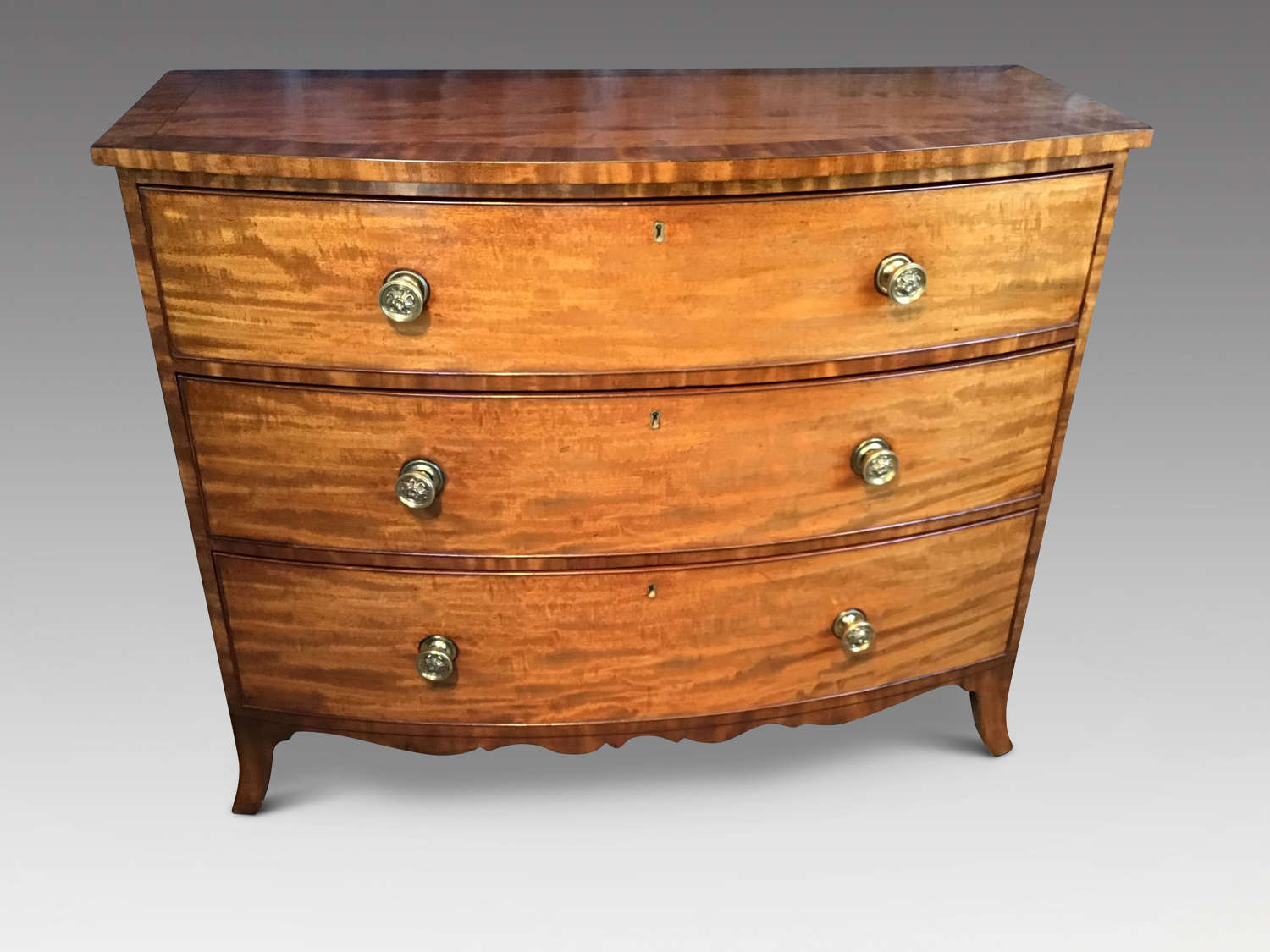 Regency bow front chest of drawers.