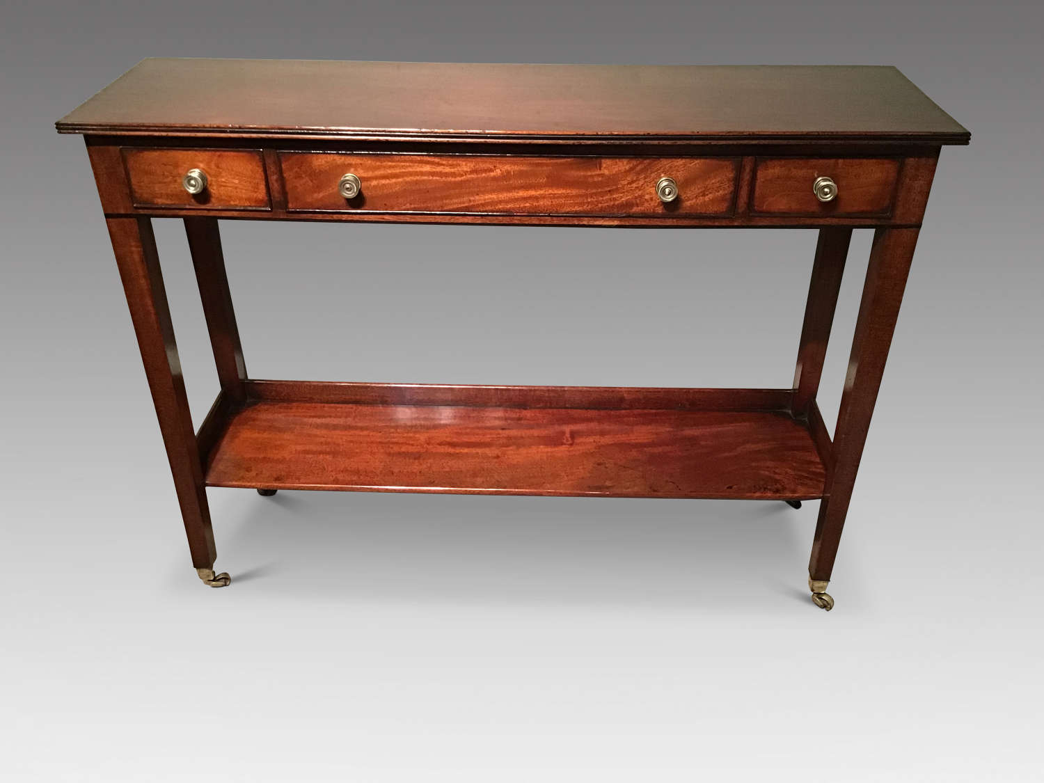 Shallow antique mahogany two tier sidetable.