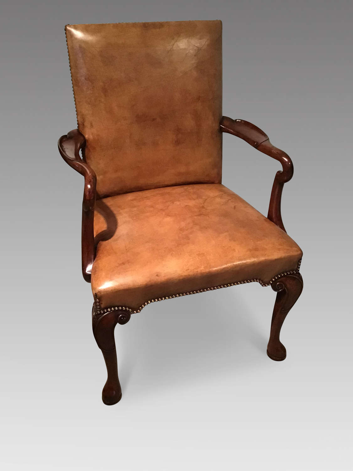 Mahogany and leather open armchair