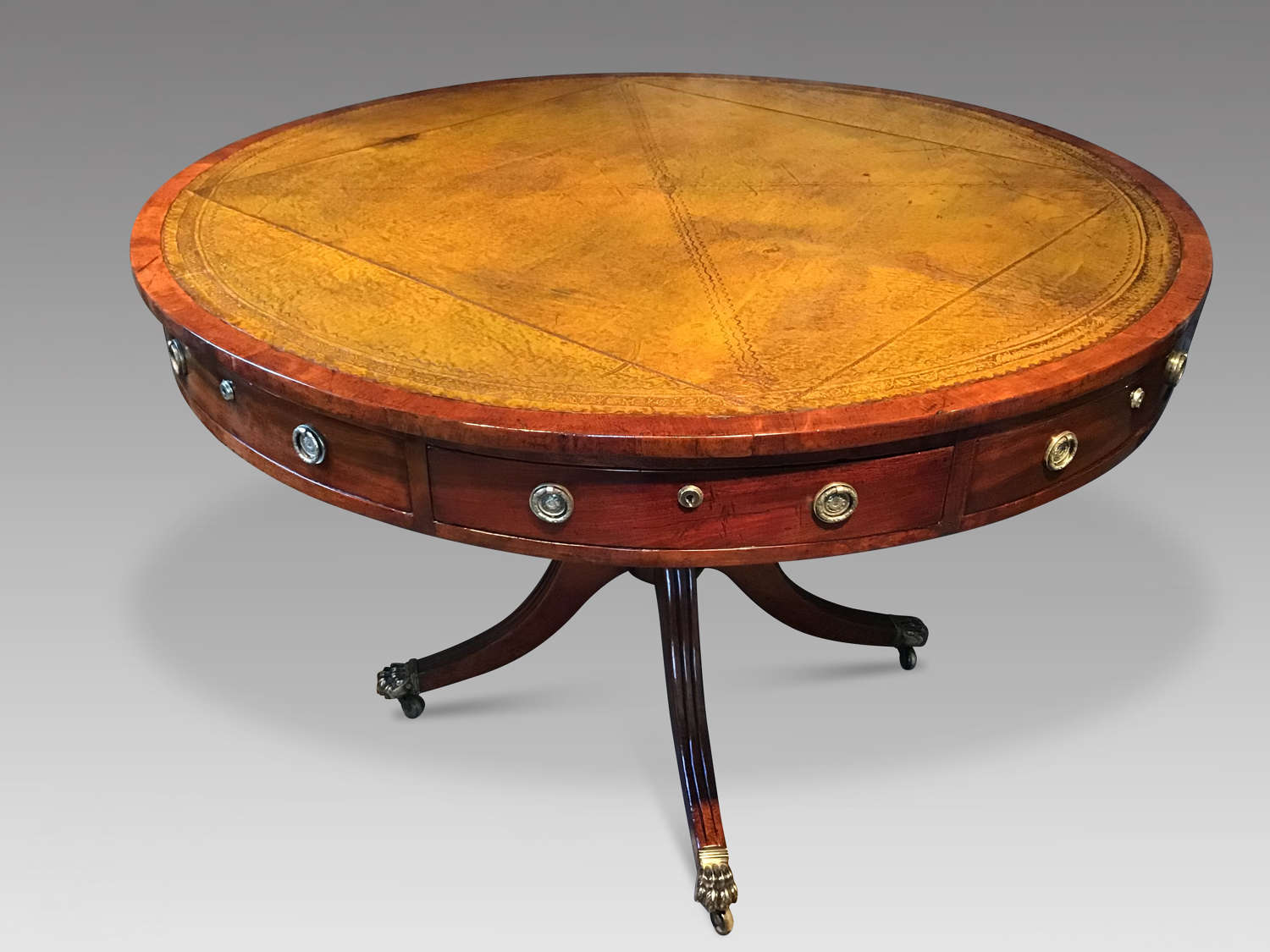 Antique mahogany drum table