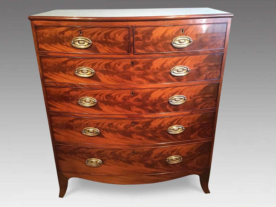Antique mahogany bow chest