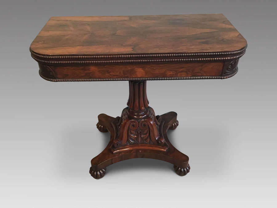 Antique rosewood tea table.