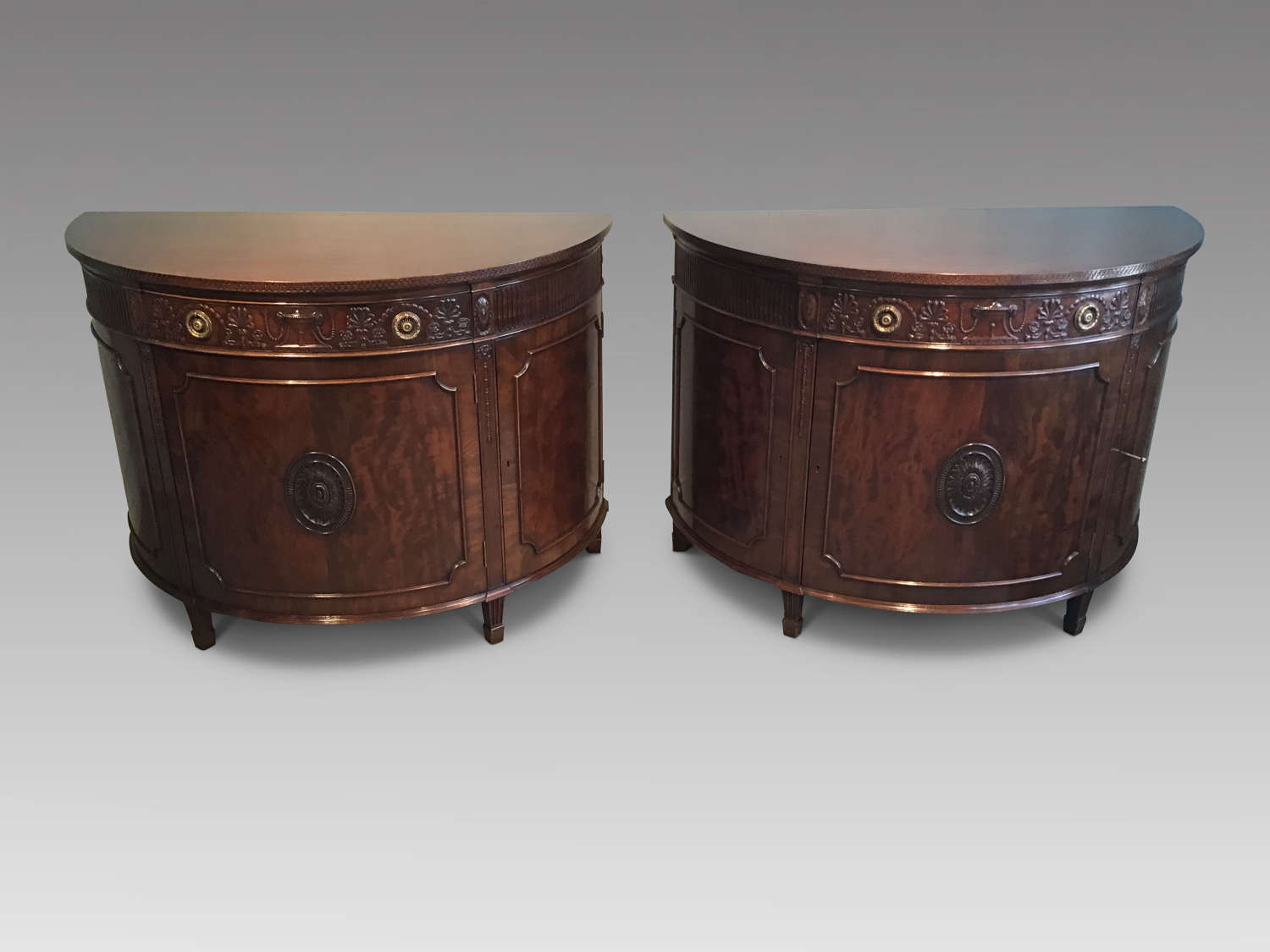 Pair of mahogany demi-lune commodes