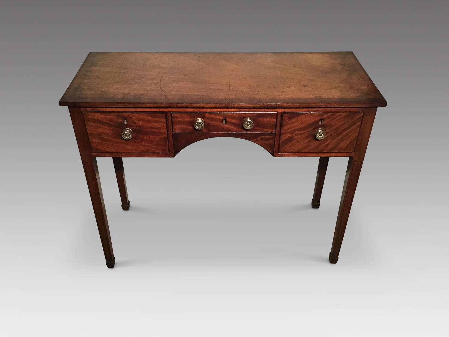 Antique mahogany kneehole table.