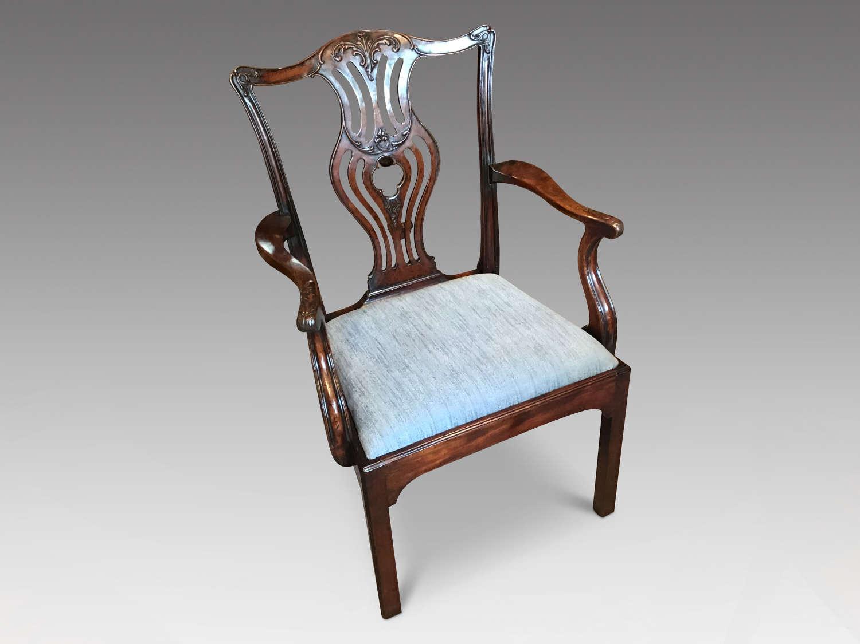 A Georgian mahogany elbow chair