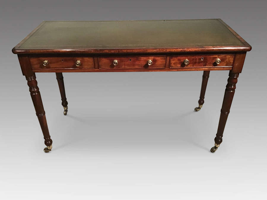 Antique mahogany writing table.