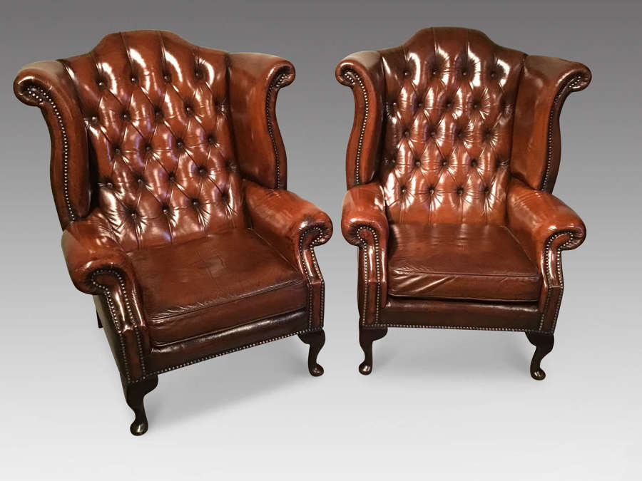 Pair of leather wing chairs