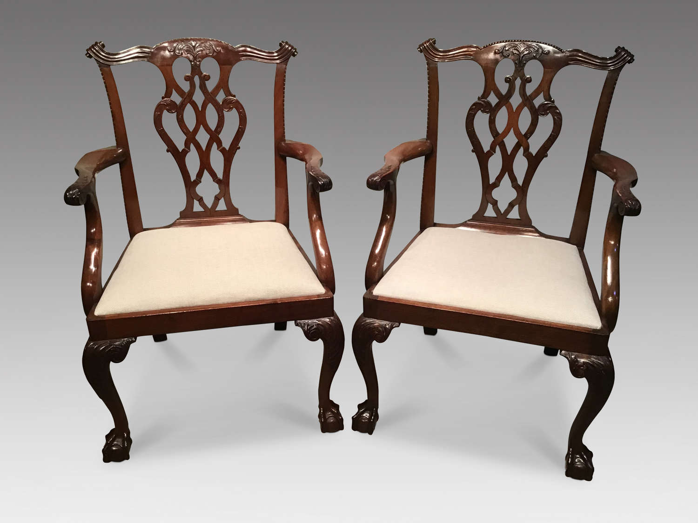 Pair of mahogany elbow chairs