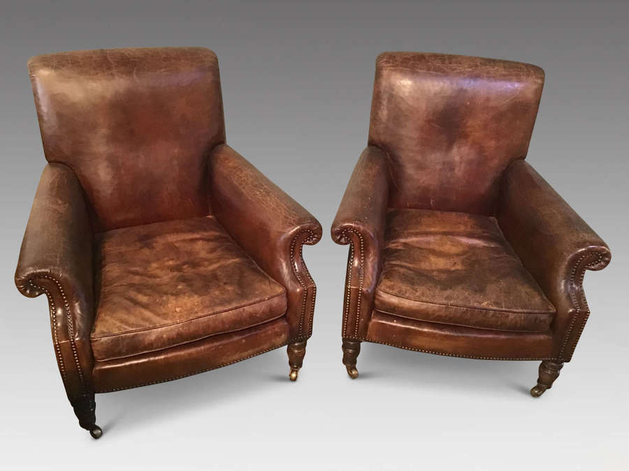 Pair leather easy chairs